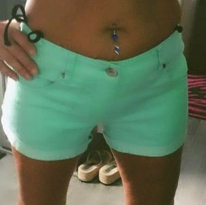 Express mint colored jean shorts